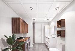 A laundry room with Embassy Ceiling's suspended ceiling system.